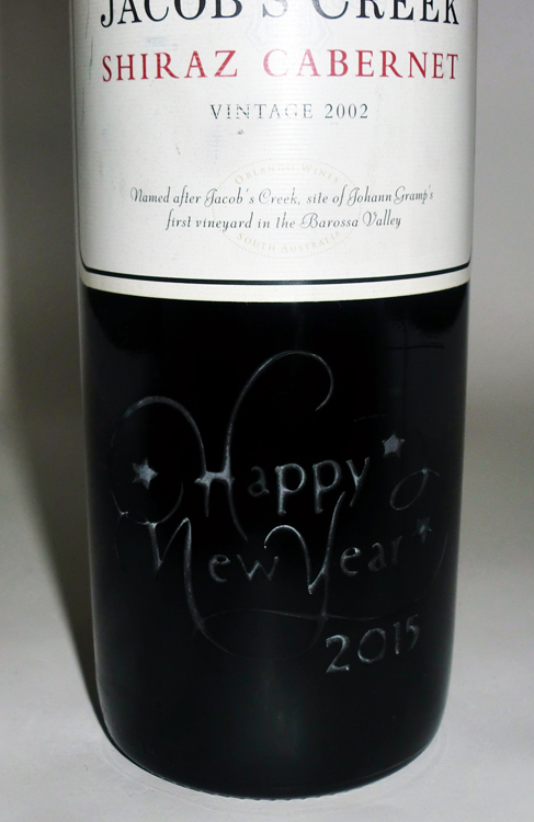 Happy New Year engraved on Jacob's Creek Cabernet
